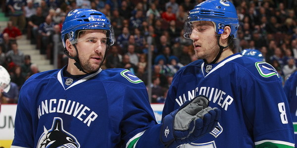 Keith-Ballard-and-Chris-Tanev-160719416-Jeff-Vinnick