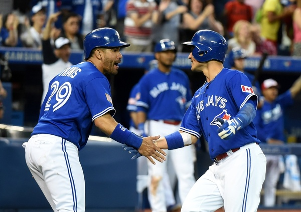 Devon Travis and Darwin Barney celebrate